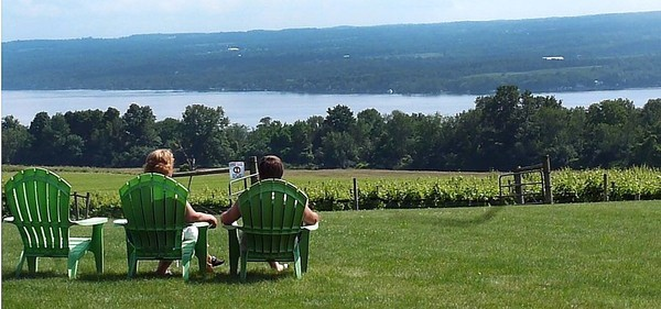 Visitors enjoy the view of Cayuga Lake at Long Point Winery in Aurora. (Stephen D. Cannerelli)