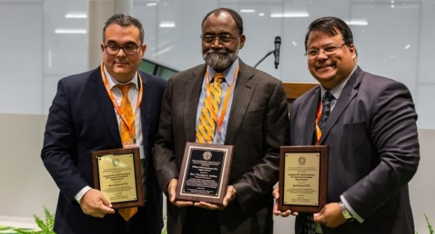 The Hon. Theodore McKee L'75 (center) received the Black Law Students Association William Herbert Johnson L'1903 Legacy Award. Judge McKee is flanked by Alex Galvez L'07 (left) and José Perez L'07, who received the LALSA Legacy Award from the Latin American Law Students Association.