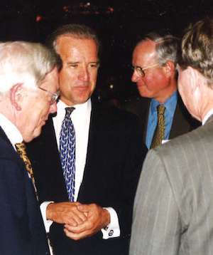 From left, Professor Emeritus Tom Maroney, President Biden, Don MacNaughton, and an unidentified guest at the Class of 1968's 30th reunion.