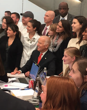 President Biden poses with Syracuse Law students during his 2016 visit to Dineen Hall.