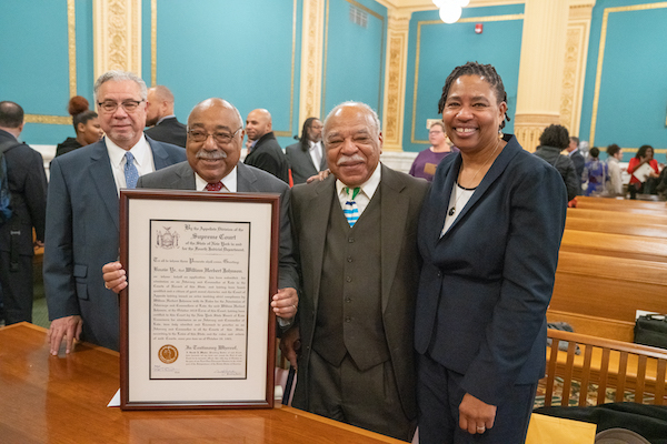 Tom Johnson, Don Johnson and Calvin Johnson, grandsons of William Herbert Johnson L'1903, with College of Law Professor Paula Johnson (no relation) at the Onondaga County Courthouse following the ceremony in which William Johnson was admitted posthumously to the New York State Bar.
