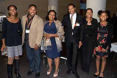 alumni and students posed together at a Law Reunion reception