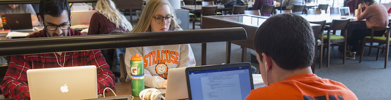 SU College of Law student studying in the Law Library Reading Room