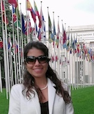 Carla Villarreal Lopez LL.M. '17 standing at the Alley of the Flags, Palais Des Nations, Geneva, Switzerland.