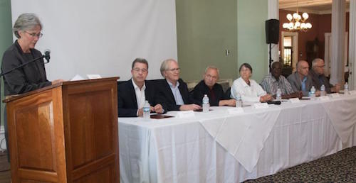 Betsy Anderson (standing) with (seated left to right): Brammertz, Crane, Goldstone, Hollis, Jallow, Koumjian, Stewart,