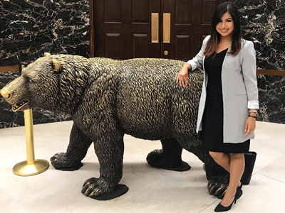 Deol poses with a bear statue within the California State Capitol