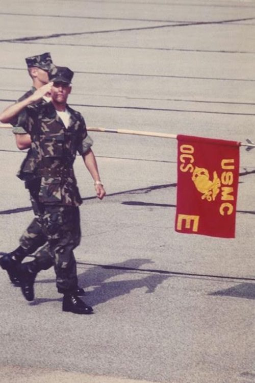 Hon. James E. Baker salutes after graduating from the Marine Officer Candidates School.