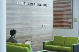 Law student sitting in Law Library reading room